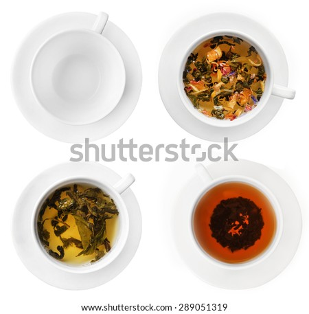 Cups of herbal tea isolated on white - stock photo