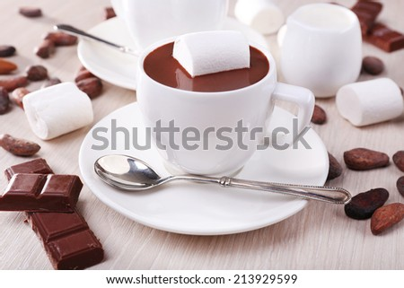 Cups of hot chocolate on table, close up - stock photo