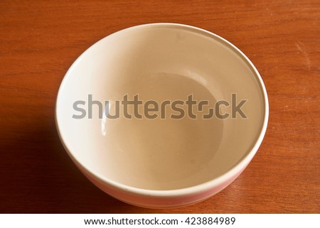 cups on a wooden table .
