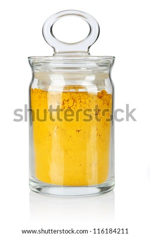 Curcuma in glass bottle isolated on white background