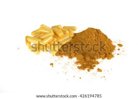 curcuma powder and food supplement pills - stock photo