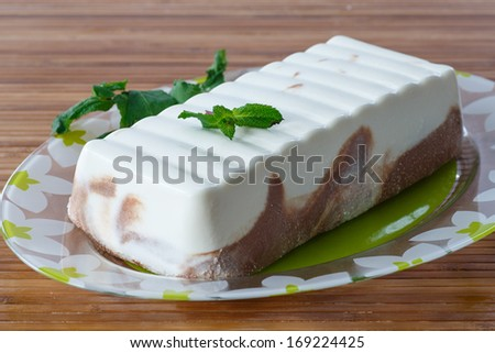curd dessert on a plate with mint