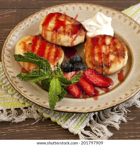Curd pancakes with fresh berries - stock photo