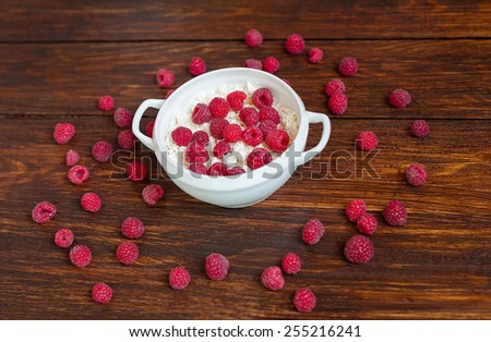 Curd with ripe raspberries - stock photo
