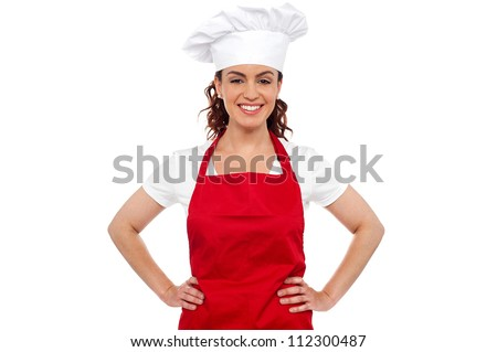 Cure female chef posing with hands on her waist. Calm and relaxed
