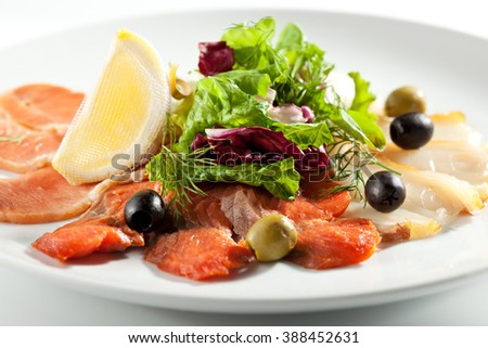 Cured FIsh with Lemon and Salad Leaf - stock photo