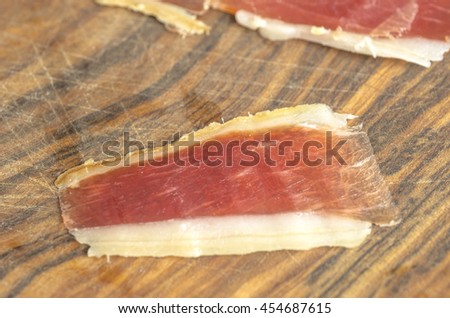 Cured iberian ham leg, bellota ham. Gourmet spanish food.