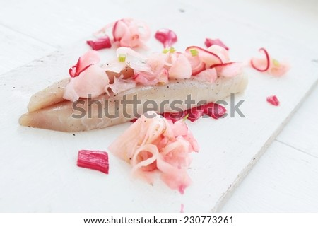 cured mackerel with rhubarb starter plated appetizer - stock photo