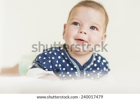 Curious and Smiling Caucasian Newborn LIttle Girl. Horizontal Image Composition - stock photo