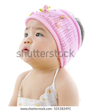 Curious Asian baby girl looking at blank side - stock photo
