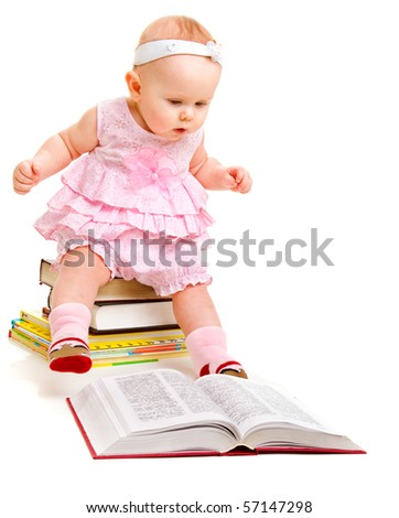 Curious baby girl reading a book - stock photo