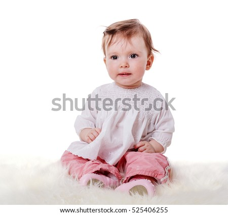 Curious Baby sitting on fur looking at you isolated on white