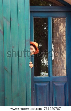 Curious boy hiding behind the door & Curious Boy Hiding Behind Door Stock Photo (Royalty Free) 731220787 ...