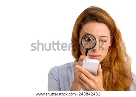 Curious. Business woman looking through magnifying glass at smart phone screen isolated white background. Human face expression. Investigator searching. Security safety concept. Complicated technology - stock photo