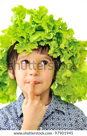 Curious little kid with salad on his head as hat - stock photo