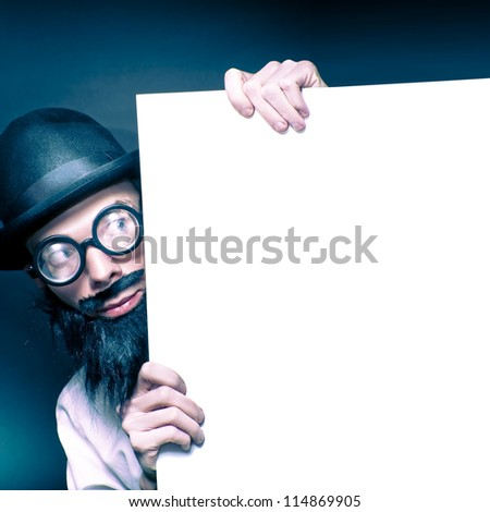 Curious Looking Old Nerd Holding Blank Copyspace Billboard On Black Background - stock photo