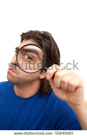 Curious man holding a magnifying glass