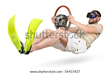 Curious man in flippers and shorts with a wheel racing (isolated) - stock photo