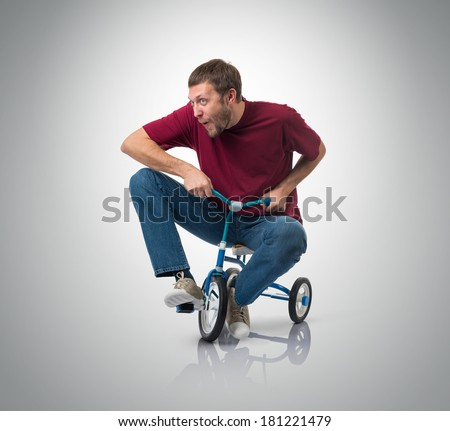 Curious man on a children's bicycle. - stock photo