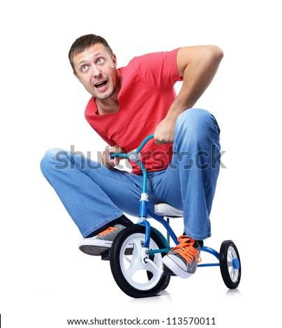 Curious man on a children's bicycle on white background, isolated path included - stock photo