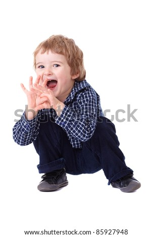 Curious 3 year old boy in blue shirt makes funny pose, isolated on white - stock photo