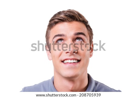 Curious young man. Cheerful young man looking up and smiling while standing isolated on white background - stock photo