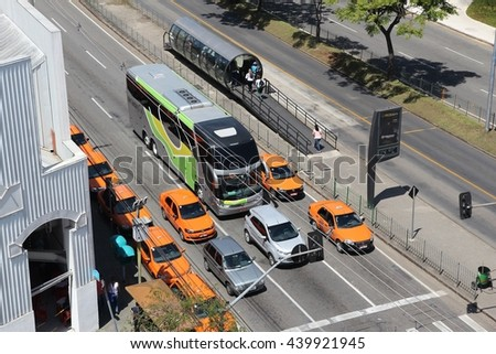 CURITIBA, BRAZIL - OCTOBER 7, 2014: Taxi cabs drive in Curitiba, Brazil. Curitiba is the 8th most populous city of Brazil with 1.76 million inhabitants. - stock photo
