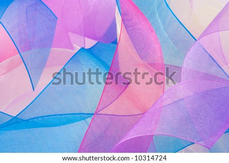 Curled and multicolored organza ribbons make up this vibrant background. - stock photo