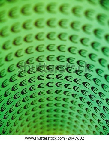Curled rows of Euro symbols on green. - stock photo