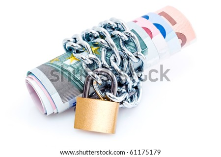 Curled stack of bank notes secured with padlock and chain, isolated on white background - stock photo