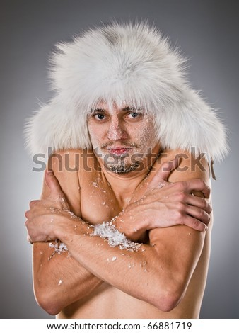 Curled up young man with which face covered with hoarfrost - stock photo