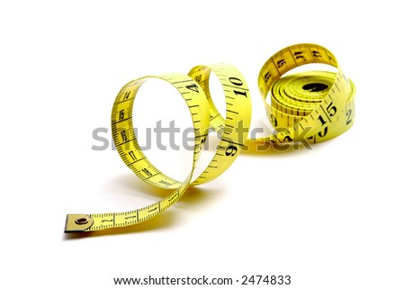 Curled yellow measuring tape on white background, angled left. - stock photo