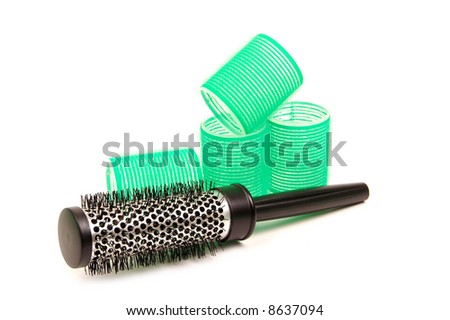 Curlers with hairbrush on white - stock photo