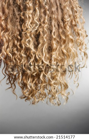 curling hair against grey background - stock photo