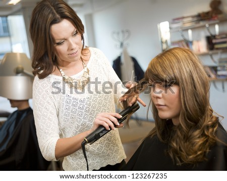 Curling hair at the Beauty salon - stock photo