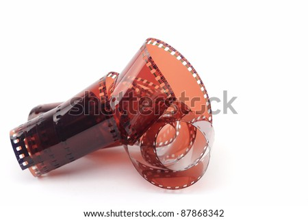 curling 35mm film. - stock photo