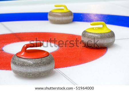 Curling stones - stock photo