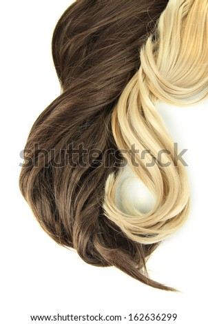Curly blond and brown hair close-up isolated on white