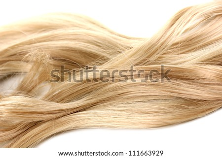 Curly blond hair close-up isolated on white