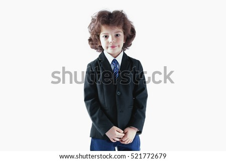 Curly boy in a white shirt, jacket and tie, looking at the camera. White background.