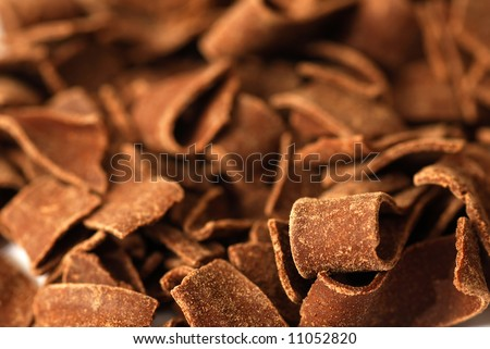 Curly chocolate chips waiting to be eaten. - stock photo