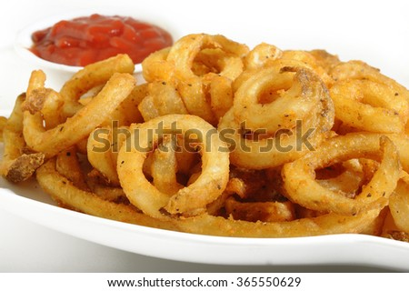 Curly Fries with ketchup  - stock photo
