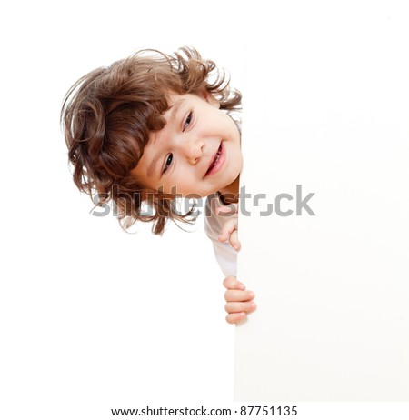Curly funny child face holding blank advertising banner - stock photo