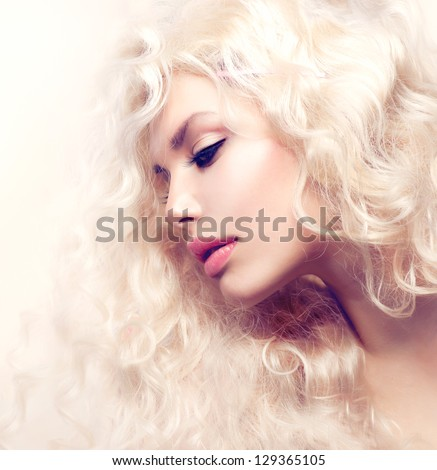 Curly Hair. Fashion Model Girl With Healthy Long Wavy Hair. Beauty Blonde Woman Portrait. Blond Hair, Hair Extension, Permed Hair - stock photo