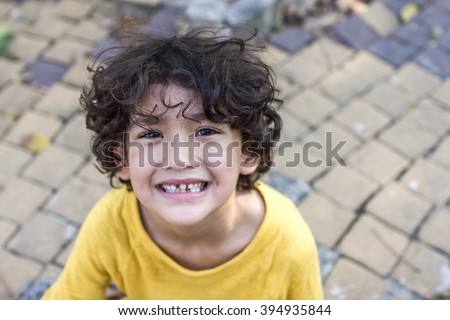 Curly Hair Mixed Kid With Natural Loose Tooth Toned Color And Lighting Selective Focus