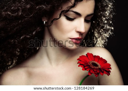 curly hair  young woman beauty portrait with flower - stock photo
