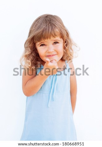 Curly little girl giving thumb up - stock photo