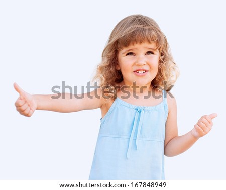 Curly little girl giving thumbs up - stock photo