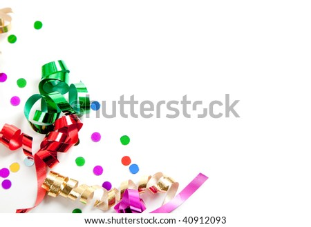 Curly ribbon and confetti on a white background with copy space - stock photo