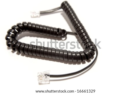 Curly telephone cord over white
